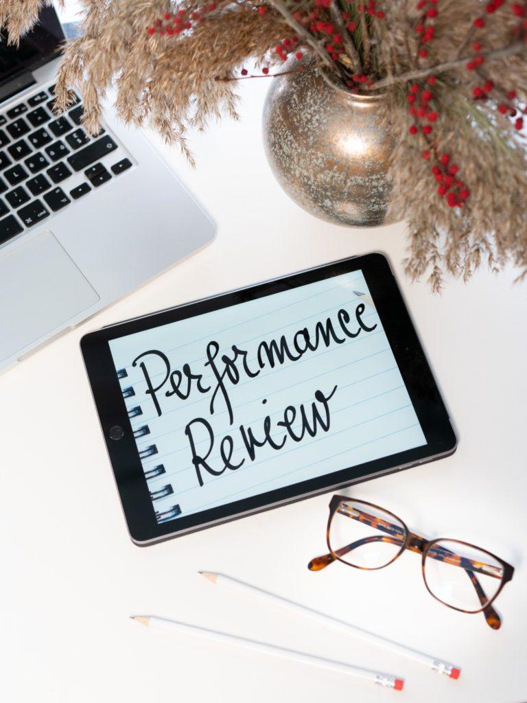 employee performance review office desk avilavi blog
